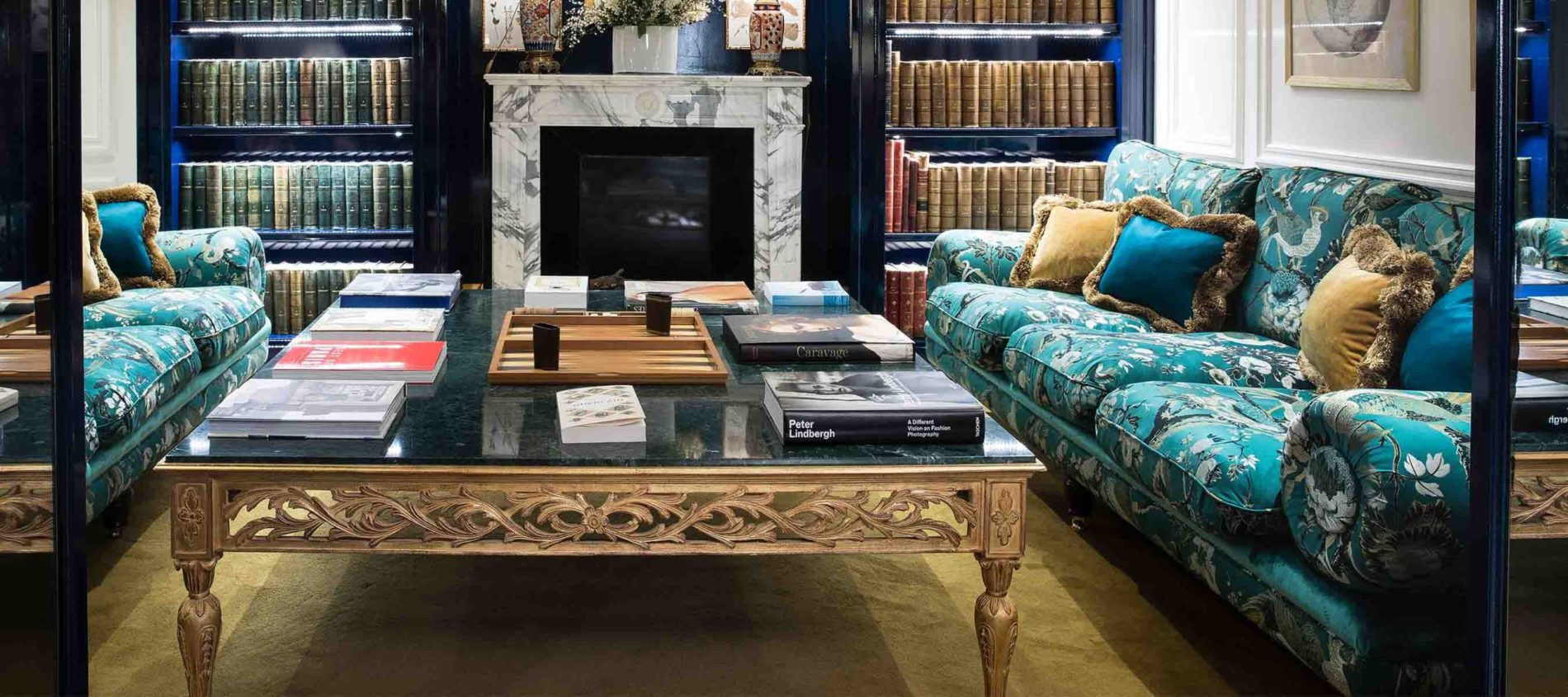 Patterned Turquoise cushioned sofa with scatter cushions in library