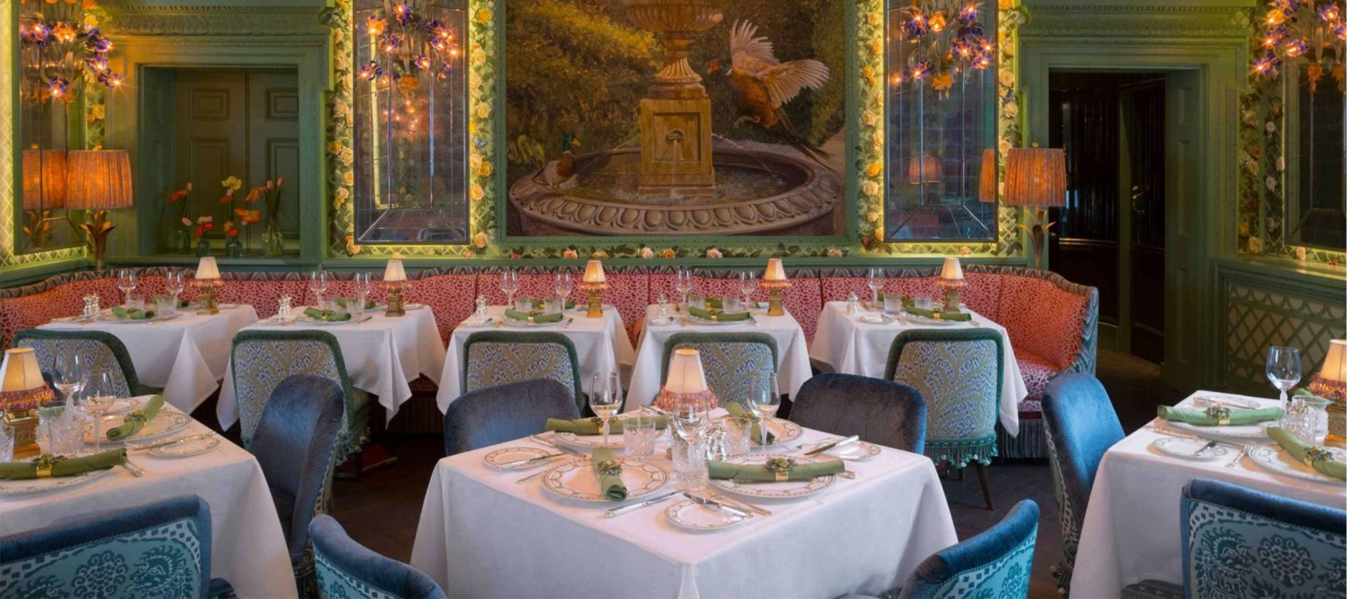 Annabel's Restaurant with blue chairs and large wall mural