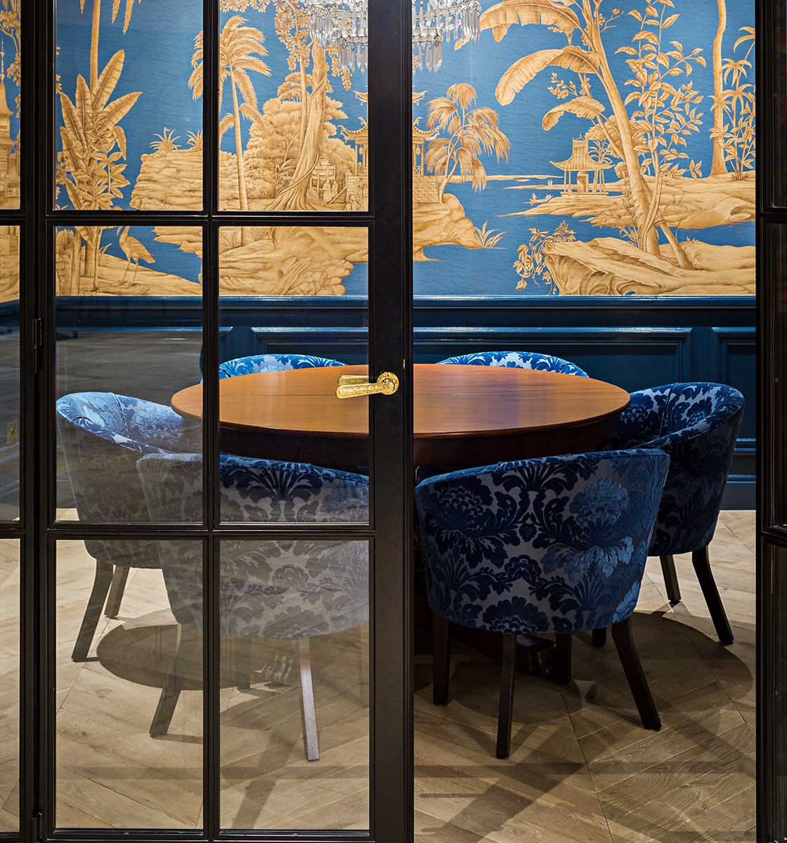 6 Dining chairs in Japanese inspired room tucked into table