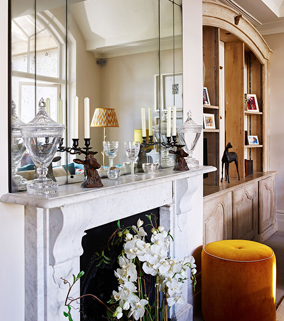 Fireplace with orchid, marble mantlepiece, bright yellow one button drum