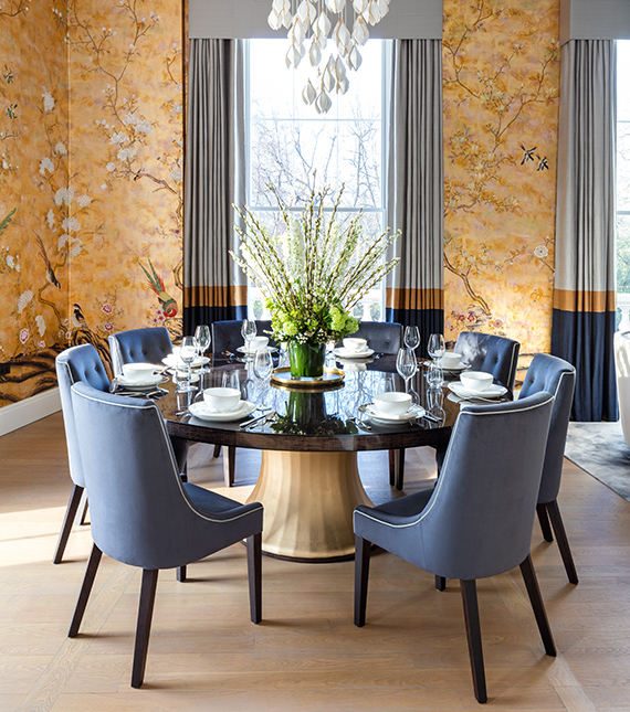 8 Dining chairs in Gold wallpapered room
