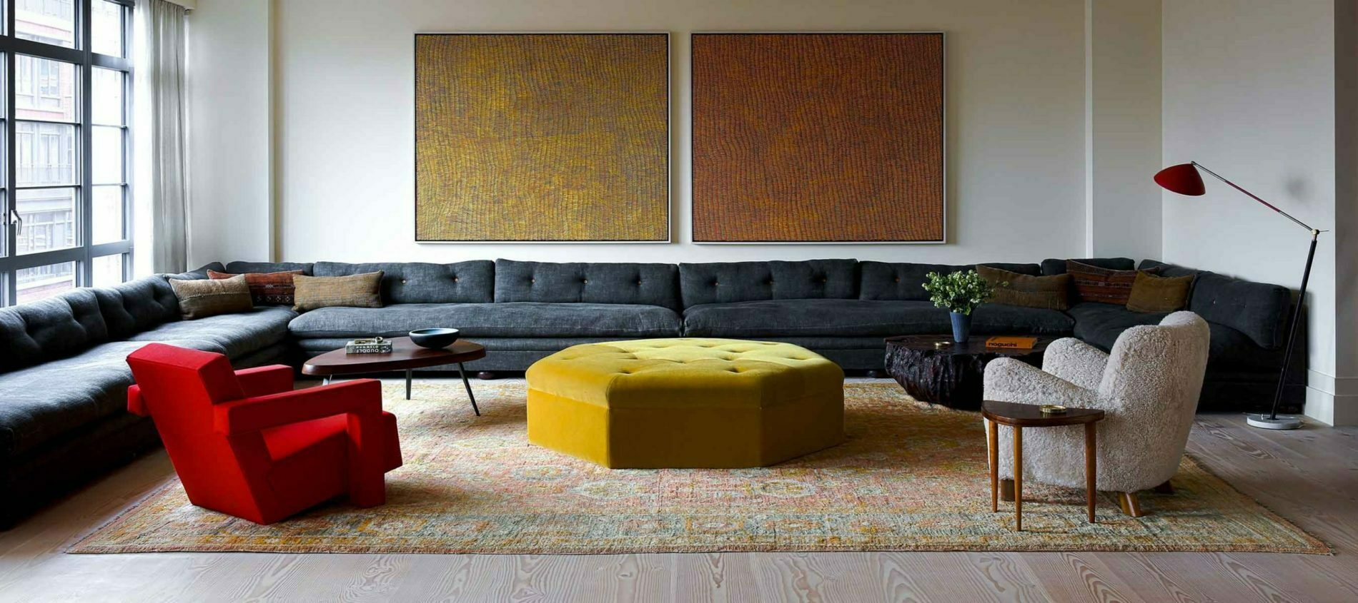Large Bespoke Turkish sofa, size of living room around yellow heptagonal pouffe