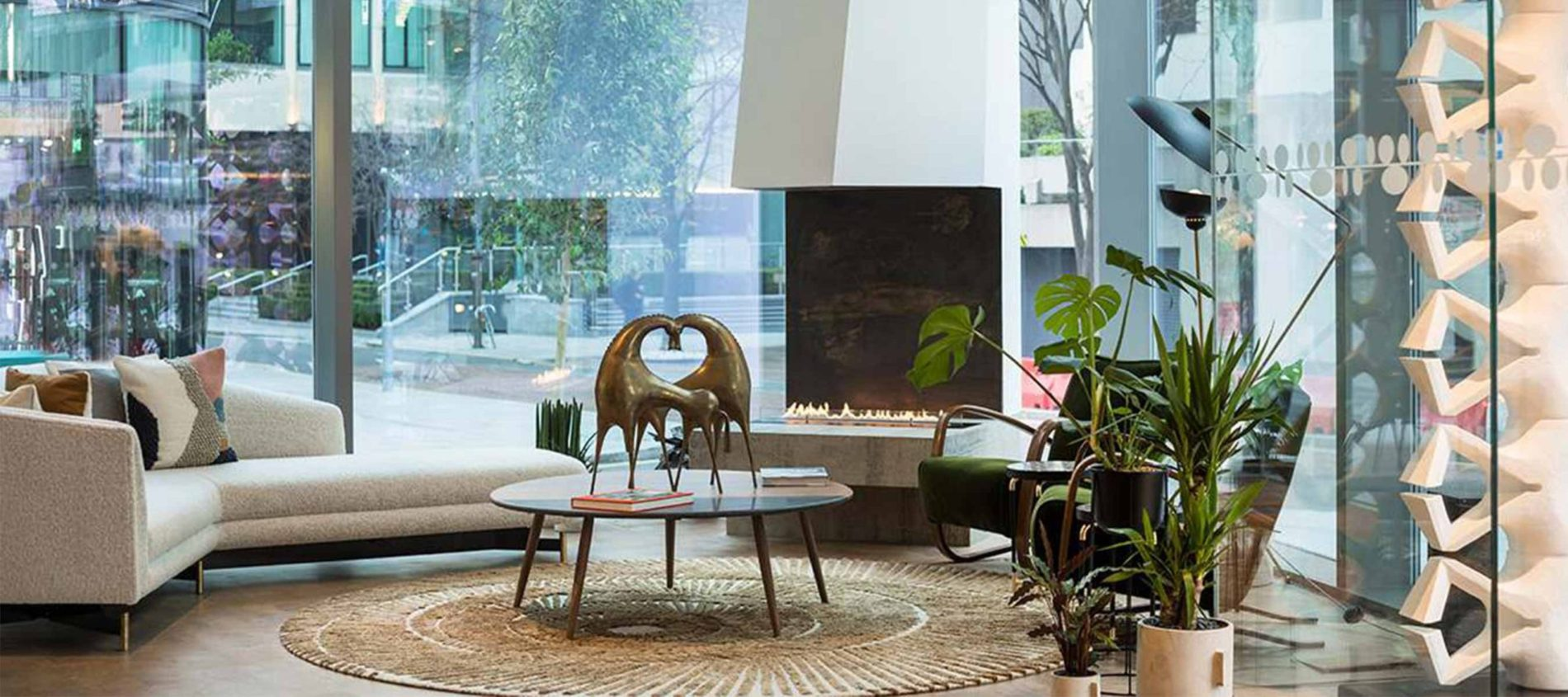 Modern lobby with sculptures, white L shape sofa and coffee table