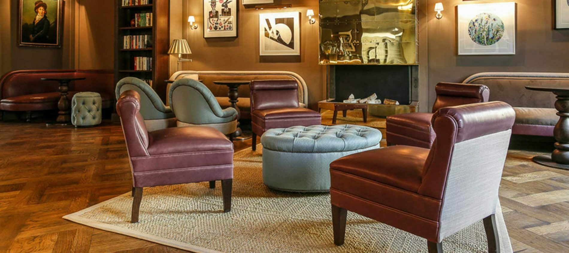 Mondian Hotel Lobby with purple leather chairs around light blue buttoned pouffe