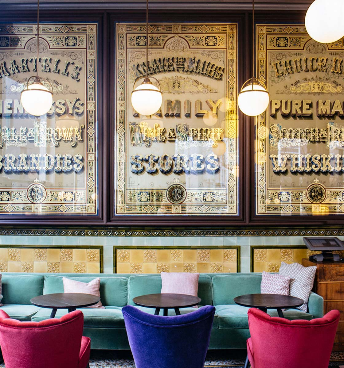 Colourful chairs and sofa in french style restaurant