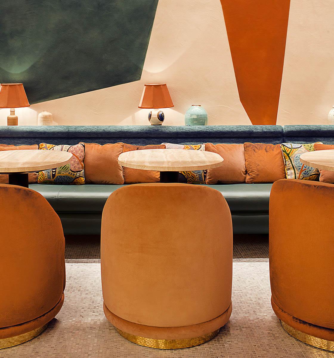 Orange tub chairs in restaurant